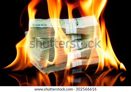 Thai money bill on fire with black background - stock photo