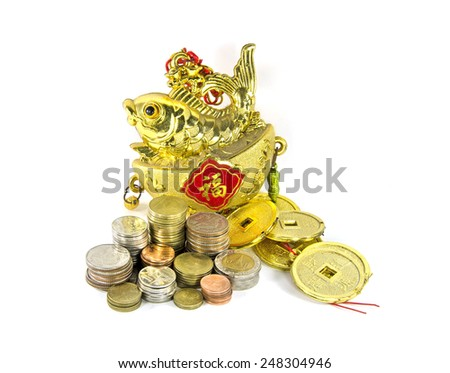 thai money coins with golden chinese toy - stock photo