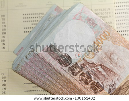 Thai money on Saving Account Passbook - stock photo