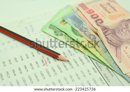 Thai money on two Saving Account Passbook - stock photo