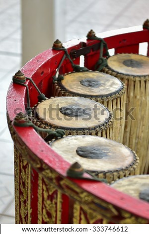 Thai musical instrument ,Gong Instrument for rhythm( select focus at drumstick ) Thai old xylophone traditional musical instrument  - stock photo