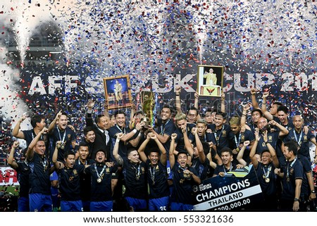 Thai National team celebrates winning the AFF SUZUKI CUP 2016 Final Rounds Match Thailand and Indonesia at Rajamangala Stadium on December 17,2016 in Bangkok,Thailand.