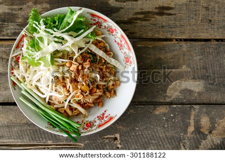 Thai noodle / pad Thai / fried noodle   on vintage wooden background - stock photo