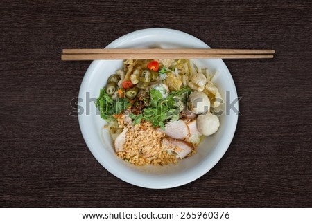 Thai Noodle with meat ball and  crispy pork skin - stock photo