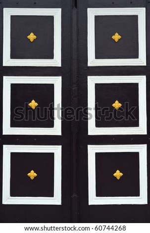 Thai old wooden door. - stock photo