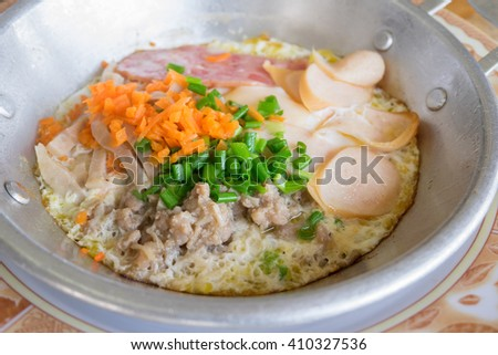 Thai pan fried egg with chopped Scallion, diced carrot, ham and sliced sausage - stock photo