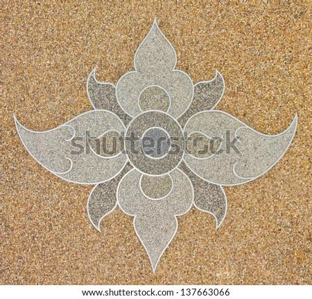 Thai pattern style on gravel stone floor interior decoration - stock photo