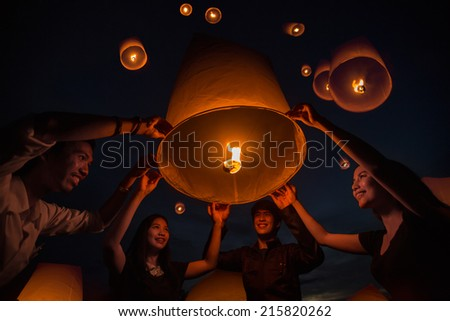 Thai people floating lamp in Tudongkasatarn, Chiangmai, Thailand. Tudongkasatarn is where floating lamp ceremony takes place every year. - stock photo