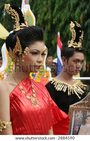 Thai people in traditional dress during in a parade, Phuket, Thailand - EDITORIAL