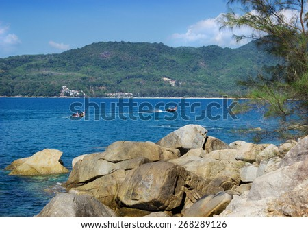 Thai pleasure boating on calm bay Andaman sea - stock photo