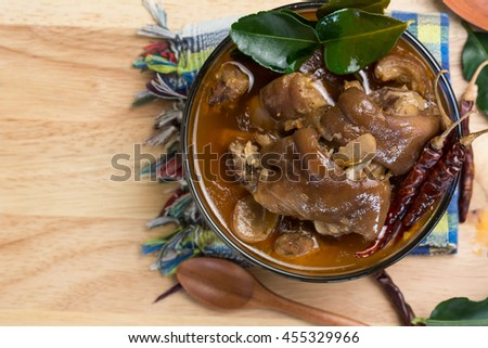 thai pork leg soup and chili in wood background,top view