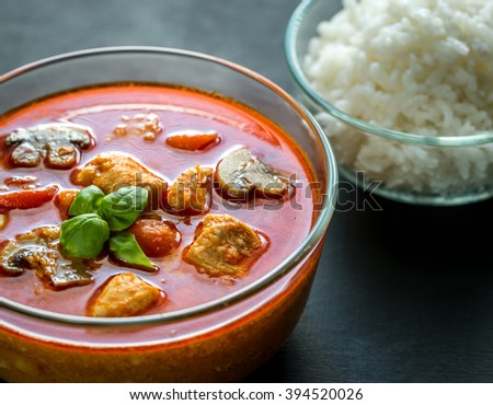 Thai red chicken curry with white rice - stock photo
