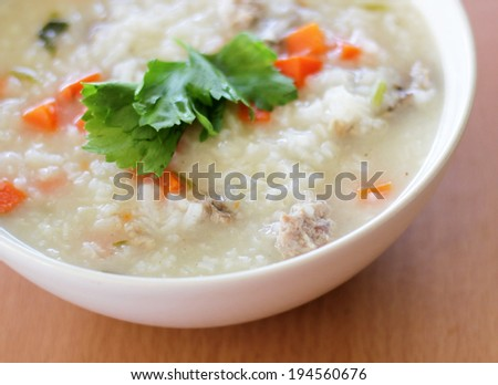 Thai rice porridge with pork and carrot