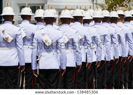 Thai Royal Guards Prepare for Marching in the Grand Palace, Bangkok, Thailand. - stock photo