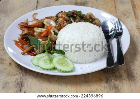 thai sea food spicy with rice - stock photo