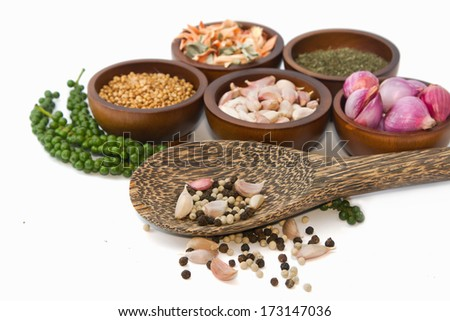 Thai seasoning ,dried herbs and spices ( garlic, shallot, coriander, dried lemon grass, cinnamon basil and pepper ) - stock photo