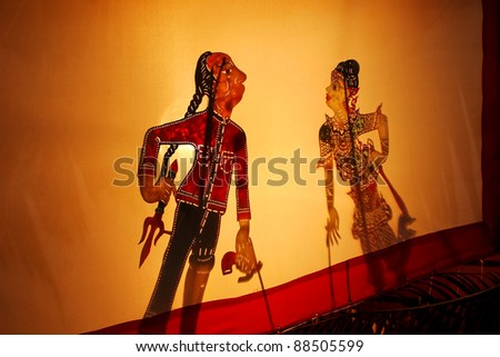Thai Shadow puppet is folk show, it playing with shadow on shadow theatre screens? It public all anyone can do it. no copyright in it / Thai Shadow puppet is folk show - stock photo
