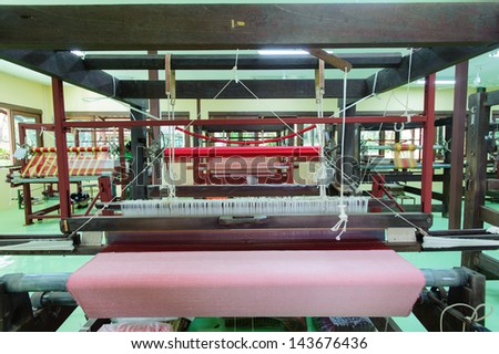 Thai silk weaving machine - stock photo