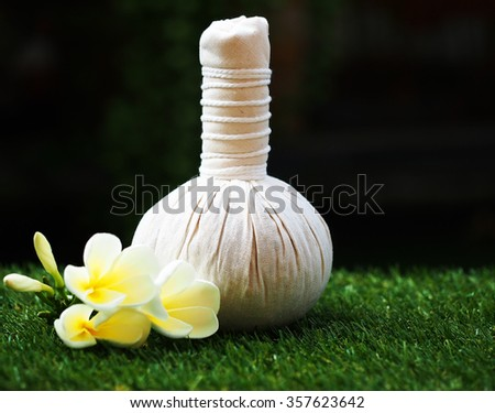 Thai spa massage compress balls , herbal ball , relax with flower. Spa Thailand - stock photo