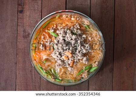 Thai spicy Tom Yam pork noodle soup with lemongrass, chilly pasted and lime juice - stock photo
