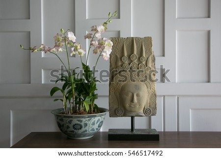 Thai statue and orchids - travel and tourism.