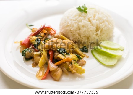 Thai stir fried chicken and basil with rice Easy to find in Thailand as street food - stock photo