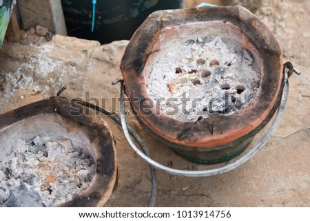 Thai stove, cooking tool. Traditional charcoal burning clay stove