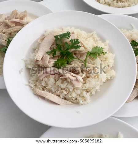 Thai streamed chicken with rice on white plate