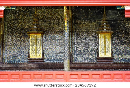 Thai style art painting wall and golden windows Thai temple bangkok Thailand - stock photo