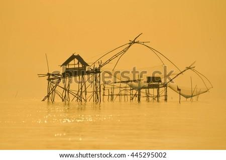 Thai style fishing trap in Pak- Pra Village, Net Fishing Thailand, Thailand Shrimp Fishing, Phatthalung in Thailand. - stock photo