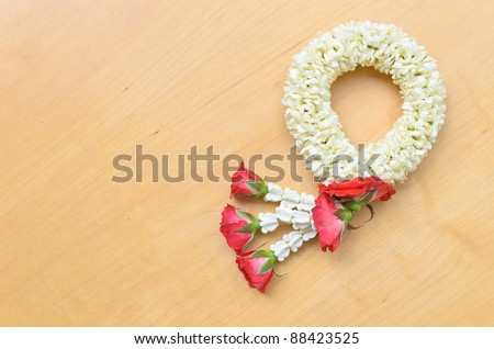 thai style garland on wood background - stock photo
