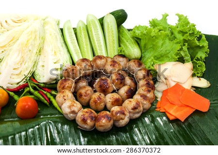 Thai style Grilled sausages with vegetable on banana leaf