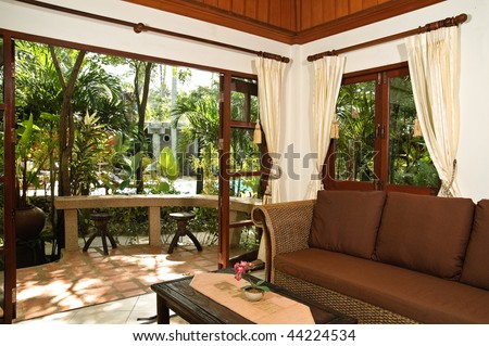Thai style living room in hotel apartment - stock photo