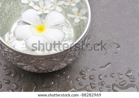Thai style SPA decoration on black marble - stock photo