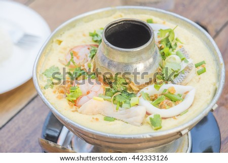 Thai style steamed eggs, Beaten Steamed Egg, Chinese steamed eggs, egg custard dish combined with various seafood ingredients and served as a main dish the delicious Thai food. - stock photo