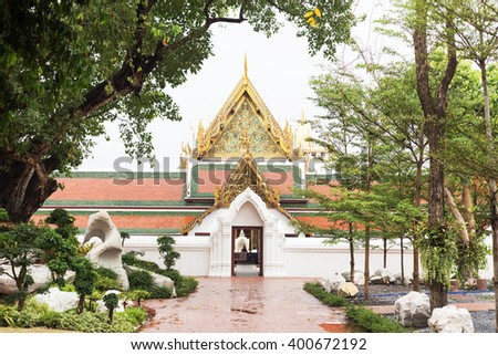 Thai style temple door.They are public domain or treasure of Buddhism, no restrict in copy or use - stock photo