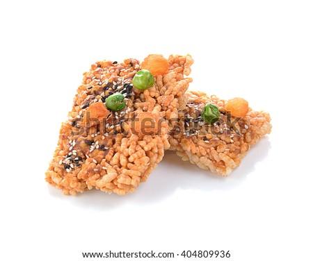 Thai Sweet Crispy Rice Cracker with Dried longan and peas - stock photo