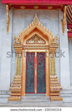Thai temple door sculpture - stock photo
