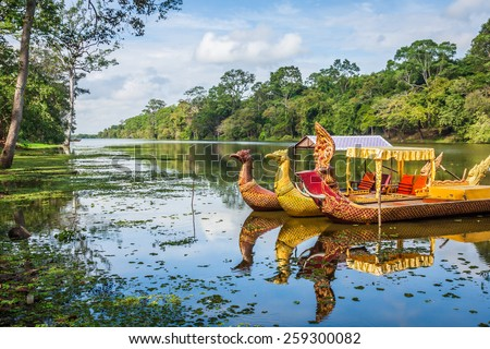 Thai traditional  boats on the lake near,Bayon temple in Angkor Thom, Siemreap, Cambodia. - stock photo