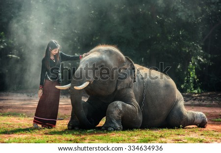 Thai Traditional fashionable lady with elephant - stock photo