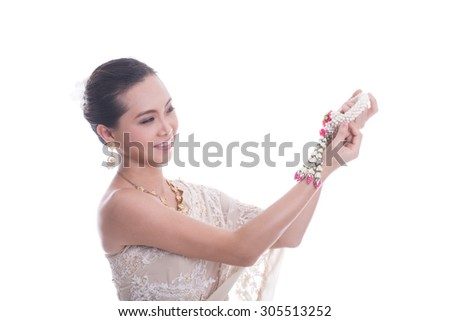 Thai Traditional holding flower with white background. - stock photo