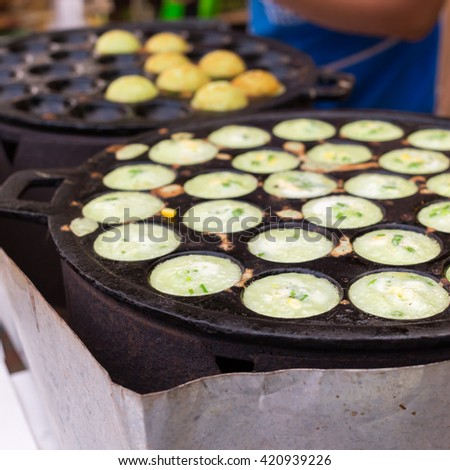 Thai traditional sweet takoyaki named mortar toasted pastry, thai dessert,Kanom Krok.