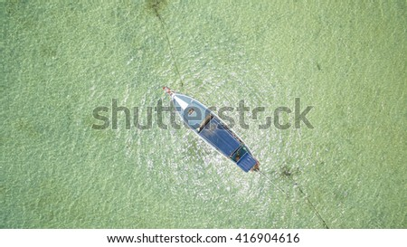 Thai traditional wooden boat for a walk. Top view from afar - stock photo