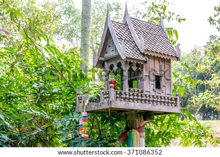 Thai traditional wooden spirit house