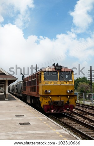 Thai train arriving at station - stock photo