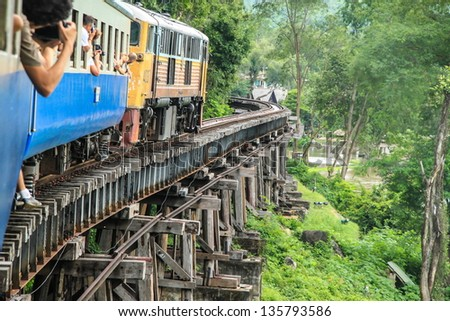 Thai Train on River Kwai Bridge of Kanchanaburi, Thailand - stock photo