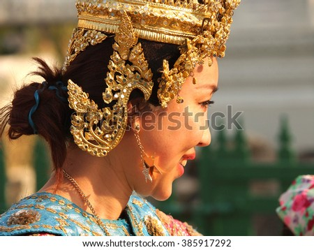 thai woman in traditional dress and crown - stock photo