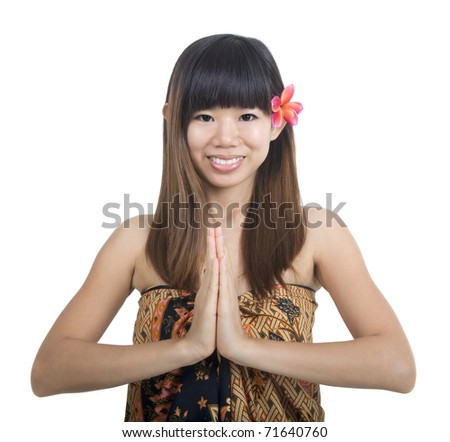Thai woman in traditional greeting gesture - stock photo