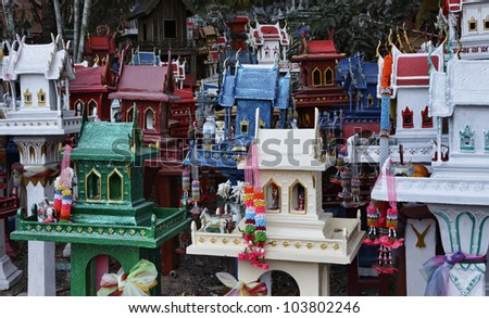 Thailand, Ayutthaya, these votive miniature temples are left in this sacred place by Thai people in memory of their dead relatives