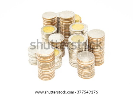 Thailand Baht coins arranged as tower on a white background. Selective focused on center image. - stock photo